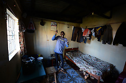 © Licensed to London News Pictures. 02/02/2014. Iten, Kenya. Running in Africa feature. Local runner Mark Kipchumba shows his shared home. Photo credit : Mike King/LNP