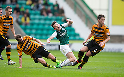Hibernian's Lewis Stevenson tackled by Alloa Athletic's Steven Hetherington. <br /> half time : Hibernian 1 v 0 Alloa Athletic, Scottish Championship game played 12/9/2015 at Easter Road.