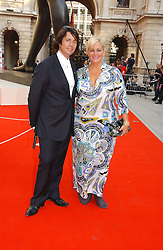 MR & MRS LAURENCE LLEWELLYN-BOWEN, he is the interior designer at the Royal Academy of Art's SUmmer Party following the official opening of the Summer Exhibition held at the Royal Academy of Art, Burlington House, Piccadilly, London W1 on 7th June 2006.<br />