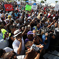 Thousands of supporters show support as Attorney Benjamin Crump speaks during a rally for the shooting of Trayvon Martin on Thursday,March 22, 2012 at Fort Mellon Park in Sanford, Florida. (AP Photo/Alex Menendez) Trayvon Martin rally in Sanford, Florida.