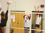 Solon's Jordan Runge (16) goes up for a spike as Maquoketa's Marlee Lindstrom (10) and Allison Vandemore (5) try to block it during the WaMaC Tournament Championship game at Mount Vernon High School in Mount Vernon on Thursday October 11, 2012. Solon defeated Maquoketa 17-25, 25-15, 15-10.