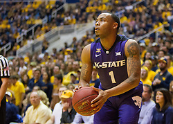 Feb 11, 2017; Morgantown, WV, USA; Kansas State Wildcats guard Carlbe Ervin II (1) shoots a three pointer from the corner during the first half against the West Virginia Mountaineers at WVU Coliseum. Mandatory Credit: Ben Queen-USA TODAY Sports