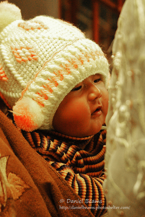 Baby in mother's arms, La Paz, Bolivia