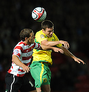 Doncaster - Tuesday September 14th, 2010:  Doncaster Rovers's Billy Sharp and Norwich City's Russell Martin in action during the NPower Championship match at Keepmoat Stadium, Doncaster. (Pic by Dave Howarth/Focus Images)