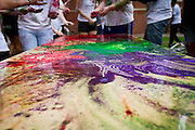 Colors blend together on a table outside Younker Hall during the Holi celebration at Grinnell College on Saturday.<br />