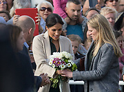 Meghan Duchess of Sussex receives flowers at the Joff Youth Centre, Peacehaven, East Sussex on 3 October 2018.