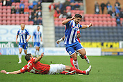 Coventry defender Aaron Martin challenges Wigan Midfielder Sam Morsy during the Sky Bet League 1 match between Wigan Athletic and Coventry City at the DW Stadium, Wigan, England on 9 April 2016. Photo by John Marfleet.