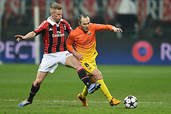 20-02-2013 VOETBAL: CHAMPIONS LEAGUE AC MILAN - FC BARCELONA: MILAAN<br />  Ignazio Abate Milan, Andres Iniesta Barcellona // during the UEFA Champions League last sixteen first leg match between AC Milan and Barcelona FC at the Giuseppe Meazza Stadium<br /> ***NETHERLANDS ONLY***<br /> ©2012-FotoHoogendoorn.nl