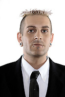 studio shot of isolated picture of a strange caucasian businessman with piercing and tattoos