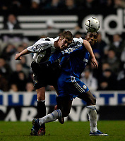 Photo: Jed Wee.<br /> Newcastle United v Chelsea. Carling Cup. 20/12/2006.<br /> <br /> Chelsea's Salomon Kalou (R) is beaten by Newcastle's Paul Huntington.