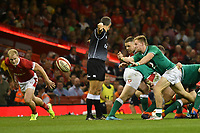 Rugby - 2019 pre-Rugby World Cup warm-up (Under Armour Summer Series) - Wales vs. Ireland<br /> <br /> Kieran Marmion; of Ireland passes the ball out, at Principality (Millennium) Stadium.<br /> <br /> COLORSPORT/WINSTON BYNORTH