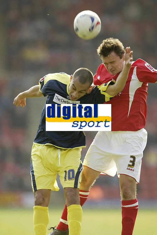 Photo: Aidan Ellis.<br /> Barnsley v Derby County. Coca Cola Championship. 31/03/2007.<br /> Derby's Craig Fagan (L) battles with Barnsley's Paul Heckingbottom