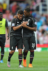 Philippe Coutinho of Liverpool celebrates with Jordon Ibe of Liverpool at full time - Mandatory byline: Dougie Allward/JMP - 07966386802 - 09/08/2015 - FOOTBALL - Britannia Stadium -Stoke-On-Trent,England - Stoke City v Liverpool - Barclays Premier League
