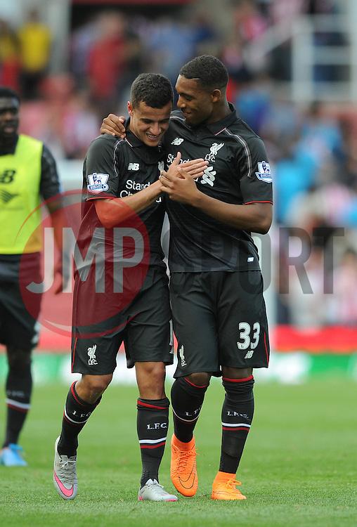 Philippe Coutinho of Liverpool celebrates with Jordon Ibe of Liverpool at full time - Mandatory byline: Dougie Allward/JMP - 07966386802 - 09/08/2015 - FOOTBALL - Britannia Stadium -Stoke-On-Trent,England - Stoke City v Liverpool - Barclays Premier League
