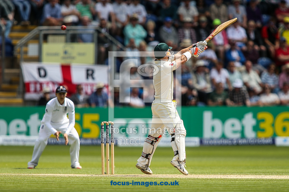 David Warner of Australia reaches for a high delivery during the Investec Ashes Series Test Match at Sophia Gardens, Cardiff<br /> Picture by Andy Kearns/Focus Images Ltd 0781 864 4264<br /> 11/07/2015
