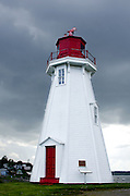 A storm brews over the Mulholland Point Lighthouse,  Campobello Island, New Brunswick.
