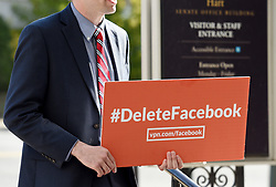 A protester with a placard stands outside Hart building where Facebook CEO Mark Zuckerberg testifies before the Senate judiciary and commerce committees on Capitol Hill over social media data breach, on April 10, 2018 in Washington, DC. Photo by Olivier Douliery/ Abaca