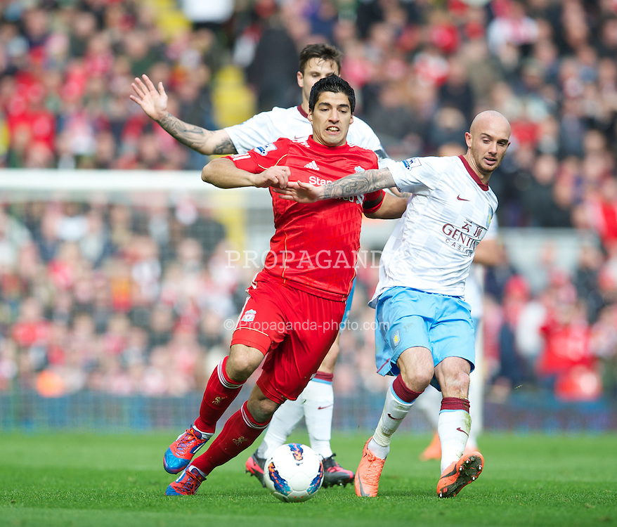 LIVERPOOL, ENGLAND - Saturday, April 7, 2012: Liverpool's Luis Alberto Suarez Diaz in action against Aston Villa's Stephen Ireland during the Premiership match at Anfield. (Pic by David Rawcliffe/Propaganda)