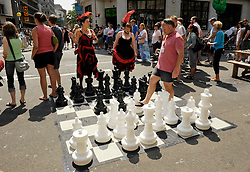 © Licensed to London News Pictures. 21/07/2013. Bristol, UK.  Make Sundays Special in Bristol, an idea instigated by the city's elected Mayor George Ferguson.  Some city centre streets are closed to traffic and street performers entertain the crowds.  21 July 2013.<br /> Photo credit : Simon Chapman/LNP