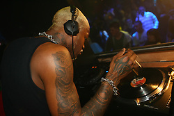 LIVERPOOL, ENGLAND - SATURDAY, MARCH 25th, 2006: Liverpool and France striker Djibril Cisse DJ's at the Isis Club in Liverpool during the UK launch of his clothing label Klubb 9. (PIc by David Rawcliffe/Propaganda)