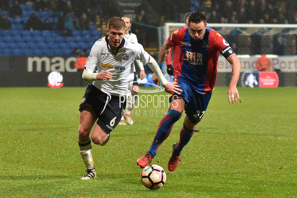 Bolton Wanderers Midfielder, Josh Vela (6) and Crystal Palace Defender, Damien Delaney (27) during the The FA Cup 3rd round match between Bolton Wanderers and Crystal Palace at the Macron Stadium, Bolton, England on 7 January 2017. Photo by Mark Pollitt.