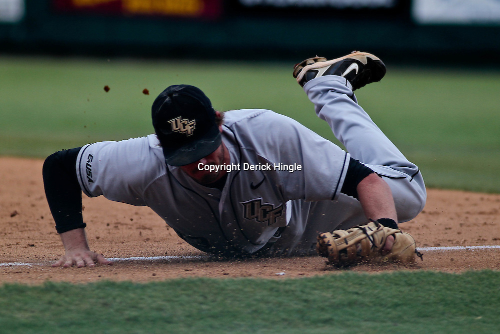 June 04, 2011; Tallahassee, FL, USA; UCF Knights first baseman Jonathan Griffin dives to make a stop during the sixth inning of the Tallahassee regional of the 2011 NCAA baseball tournament against the Bethune-Cookman Wildcats at Dick Howser Stadium. Mandatory Credit: Derick E. Hingle