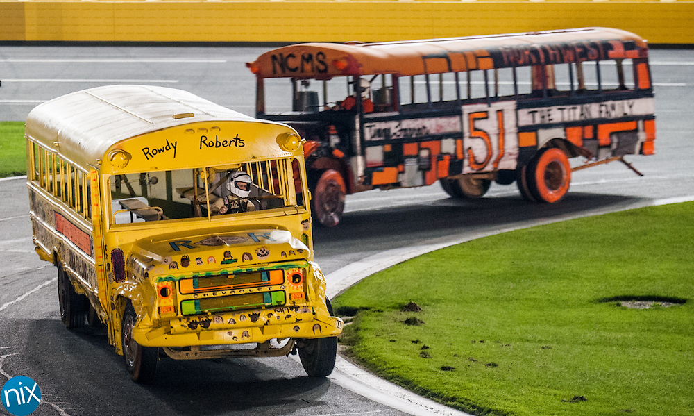 Darin Roberts, principal of Carl A. Furr Elementary, in the yellow bus,  races Tim Farrar, of Northwest Cabarrus Middle School, during the first night of the Summer Shoot out at Charlotte Motor Speedway Monday night. Roberts beat out second-place Tripp Aldredge of Harris Road Middle School, Farrar, Chuck Borders of Pitts School Road Elementary, Adam Auerbach of Wolf Meadow Elementary, Jim Carroll of Hickory Ridge Middle School and Greg Liddle of Mount Pleasant High School.