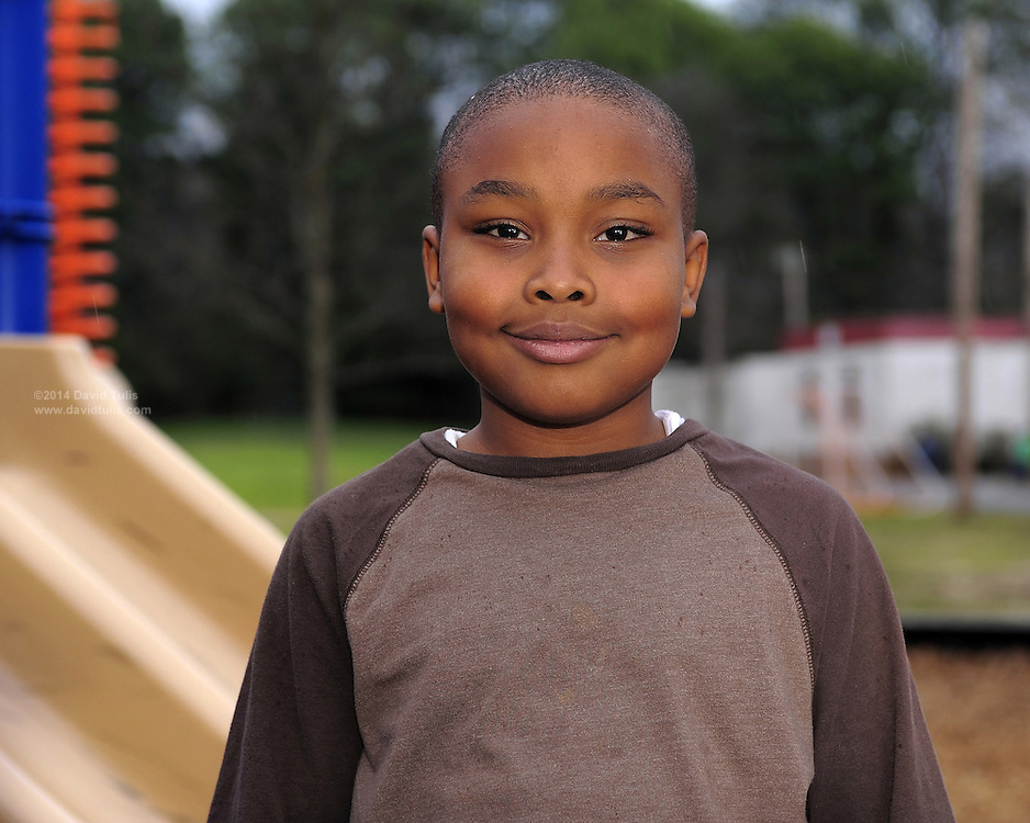 Third grader Caleb Grant in Ms. Jackson's class poses for a class photo on the Sagamore Hills Elementary School playground on Tuesday, Feb. 28, 2012.  (David Tulis/dtulis@gmail.com)