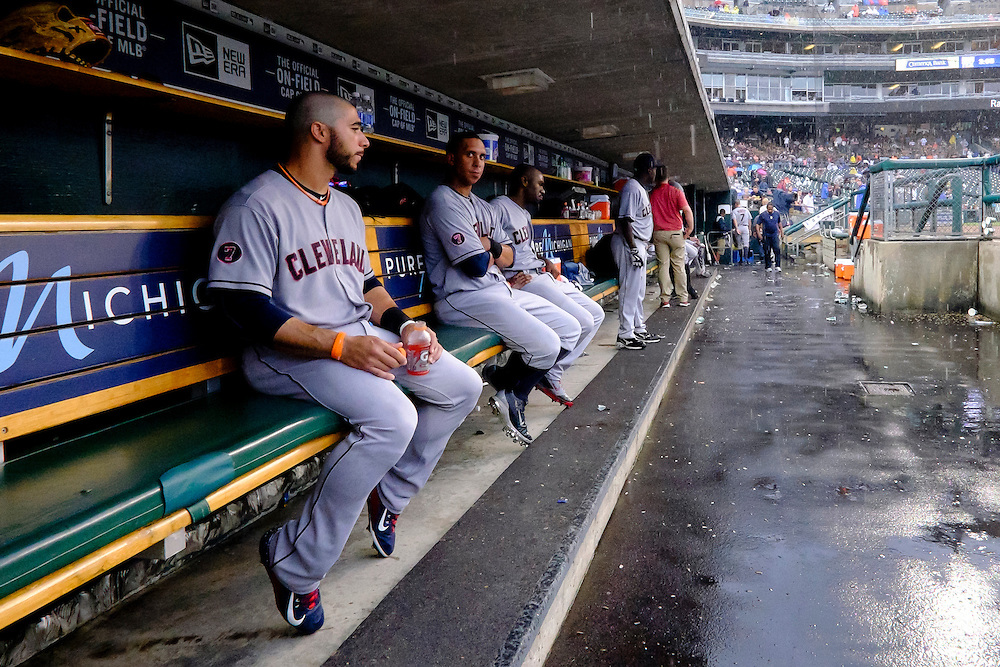 Jun 14, 2015; Detroit, MI, USA; Cleveland Indians shortstop Mike Aviles (4) left fielder Michael Brantley (23) and center fielder Michael Bourn (24) sits in dugout during a rain delay in the fifth inning against the Detroit Tigers at Comerica Park. Mandatory Credit: Rick Osentoski-USA TODAY Sports