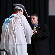 Conrad Schools of Science graduate Derek Bischoff receives his diploma during Conrad commencement exercises Saturday, June 06, 2015, at The Bob Carpenter Sports Convocation Center in Newark, Delaware.