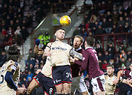 12th December 2017, Tynecastle Park, Edinburgh, Scotland; Scottish Premier League football,  Heart of Midlothian versus Dundee; Dundee's Kerr Waddell oujumps Hearts' Christophe Berra and Hearts' John Souttar