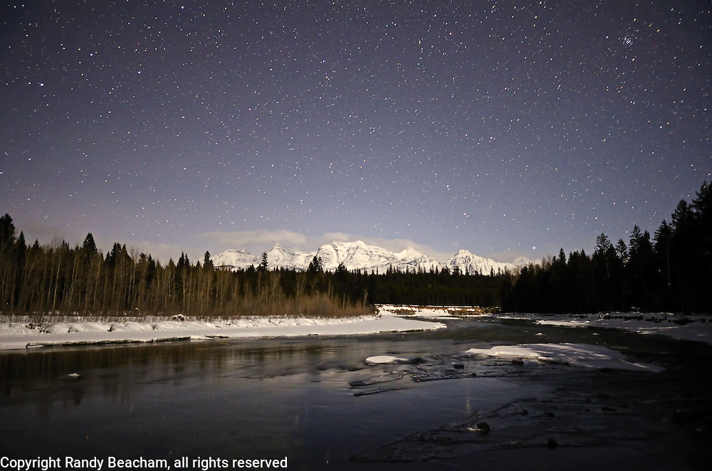 North Fork Flathead River and the Livingston Range at night by moonlight. Glacier National Park, northwest Montana.
