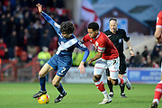 Bristol City midfielder Korey Smith holds up Birmingham City striker Diego Fabbrini during the Sky Bet Championship match between Bristol City and Birmingham City at Ashton Gate, Bristol, England on 30 January 2016. Photo by Alan Franklin.