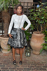 TOLULA ADEYEMI at the Warner Music Group Summer Party in association with British GQ held at Shoreditch House, Ebor Street, London E2 on 8th July 2015.