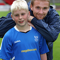 St Johnstone v St Mirren..23.08.05  CIS Cup R2<br />12 year old David Holden from Crieff who won the Perthshire Advertiser/CIS competition. He is pictured with hios favourite player Ryan Stevenson.<br />Picture by Graeme Hart.<br />Copyright Perthshire Picture Agency<br />Tel: 01738 623350  Mobile: 07990 594431