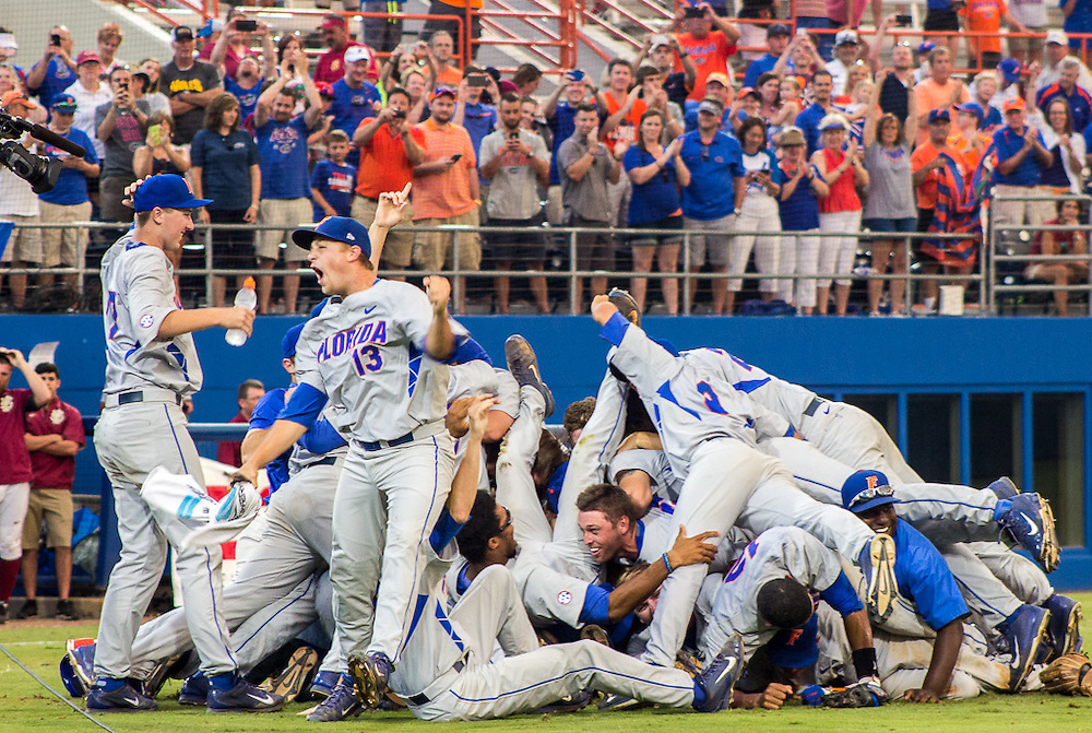 Florida baseball team celebrates Saturday's win over FSU 11-4 and guarantees a ticket to the College World Series in Ohama. (photo by Samuel Navarro)