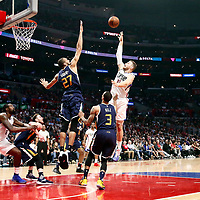 25 March 2016: LA Clippers forward Blake Griffin (32) goes for the baby hook over Utah Jazz center Rudy Gobert (27) during the Los Angeles Clippers 108-95 victory over the Utah Jazz, at the Staples Center, Los Angeles, California, USA.