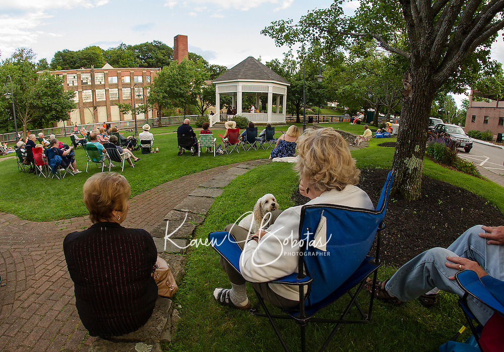 """Marilyn Summers, """"Cody"""" and Alvina Heine of Meredith enjoy Thursday's Concert by the River in Rotary Park listening to the soulful sounds of Sharon """"Sugar"""" Jones.  (Karen Bobotas/for the Laconia Daily Sun)"""