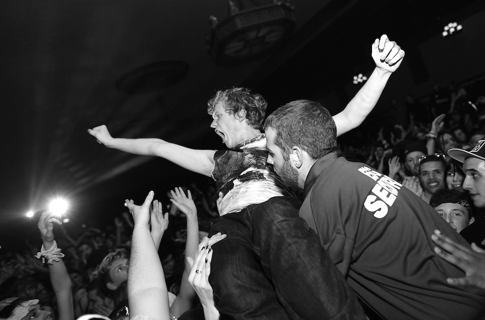 A crowd surfer is pulled in by security as dubstep artist Excision plays at the Egyptian Room  January 25, 2013. .Photo by Chris Bergin