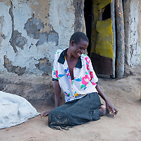 A woman suffers fisutla on the outskirts of her village near Soroti, Uganda