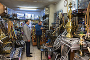 Metalworker in metal repair workshop in The Grand Bazaar, Kapalicarsi, great market in Istanbul, Turkey