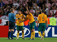 Photo: Glyn Thomas.<br />Croatia v Australia. Group F, FIFA World Cup 2006. 22/06/2006.<br /> Australia's players surround referee Graham Poll (L) after he fails to award them a penalty from a handball.
