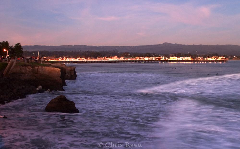 Beach Boardwalk and wharf at dusk, Santa Cruz, California