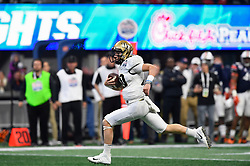 UCF Knights quarterback McKenzie Milton (10) runs for a touchdown during the Chick-fil-A Peach Bowl NCAA college football game against Auburn University January 1, 2018, in Atlanta. (David Tulis via Abell Images for Chick-fil-A Peach Bowl)