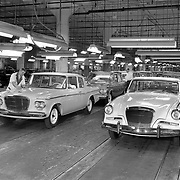1962 Studebaker final assembly.  A 1962 Lark (L) and a 1962 Gran Turismo Hawk reach the end of the assembly line.