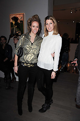 Left to right, EVEIE LONGDON and SUSANNA WARREN at the Polo Jeans Co. hosted Art Stars Auction in support of the Teenage Cancer Trust held at Phillips de Pury & Co, Howick Place, London on 6th December 2010.