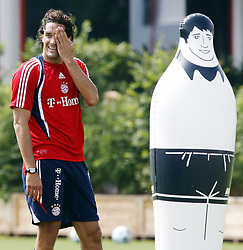 Luca Toni jokes with a inflatable player during training for Bayern Munich. August 23rd 2009.