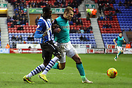 Jordan Rhodes of Blackburn Rovers shields the ball from Leon Barnett of Wigan Athletic. Skybet football league championship match , Wigan Athletic v Blackburn Rovers at the DW Stadium in Wigan, Lancs on Saturday 17th Jan 2015.<br /> pic by Chris Stading, Andrew Orchard sports photography.