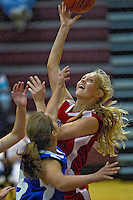 Region All-Star's Dayna Drager turns around for a shot under the basket during the Jack Blair Memorial Girls All-Star basketball game Monday at University High in Spokane Valley.