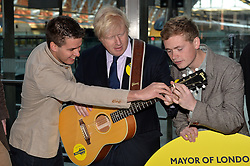 Boris Johnson meets 'The King's Parade' band at St Pancras Station before they head off to busk in Paris.<br /> Mayor of London Boris Johnson joins musicians at St Pancras Station to urge young musicians to take to the streets and continue busking in the Capital.  <br /> <br /> Wednesday, 9th April 2014. Picture by Ben Stevens / i-Images